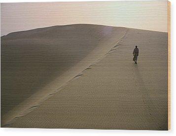 Murrah Tribesman Walking On A Large Wood Print by Thomas J Abercrombie