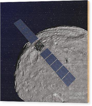 Nasas Dawn Spacecraft Orbiting Wood Print by Stocktrek Images