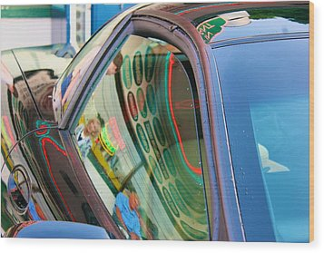 Wood Print featuring the photograph Neon Reflections On A Black Car by Polly Castor
