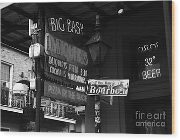 Neon Sign On Bourbon Street Corner French Quarter New Orleans Black And White Wood Print by Shawn O'Brien