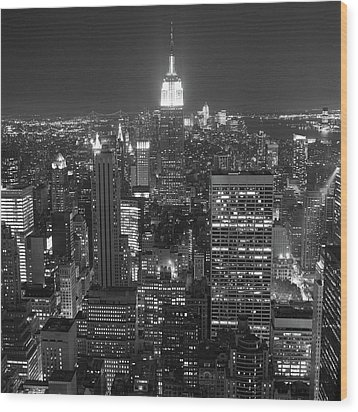 New York City At Night Wood Print by Adam Garelick