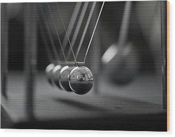 Newton's Cradle In Motion - Metallic Balls Wood Print by N.J. Simrick