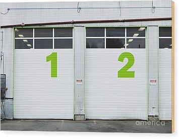 Numbers On Repair Shop Bay Doors Wood Print by Don Mason