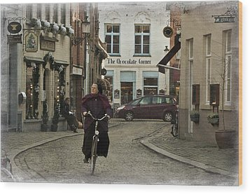 Nun On A Bicycle In Bruges Wood Print by Joan Carroll