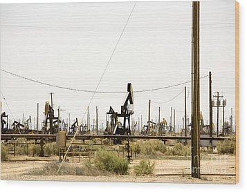 Oil Rigs, Lebec, Mojave Desert, California Wood Print by Paul Edmondson