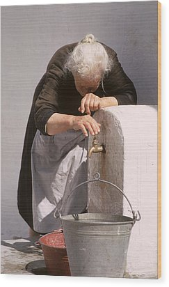 Old Lady With Water Pail Wood Print by Carl Purcell