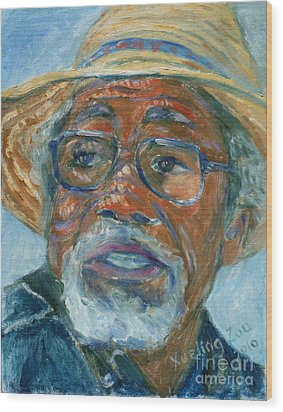 Old Man Wearing A Hat Wood Print by Xueling Zou