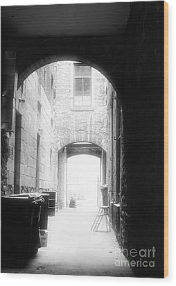 Old Montreal Alley Wood Print by John Rizzuto