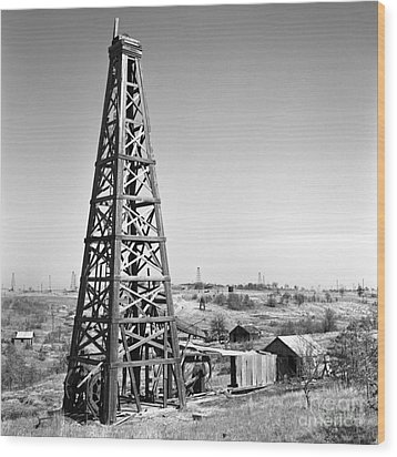 Old Wooden Derrick Wood Print by Larry Keahey