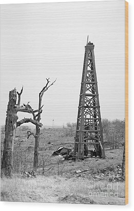 Old Wooden Oil Derrick Wood Print by Larry Keahey