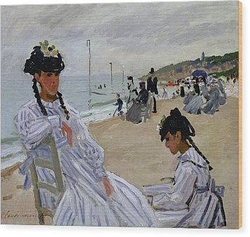 On The Beach At Trouville Wood Print by Claude Monet