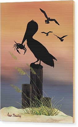 Pelican At Sunset Wood Print