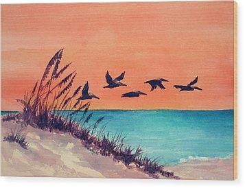 Pelicans Flying Low Wood Print