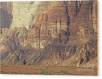 Person Riding A Motorbike Through The Wadi Rum Desert In Jordan Wood Print by Sami Sarkis