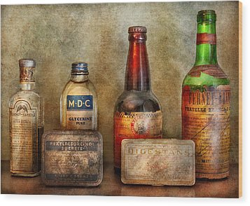 Pharmacist - On A Pharmacists Counter Wood Print by Mike Savad