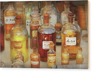 Pharmacy - Serums And Elixirs Wood Print by Mike Savad