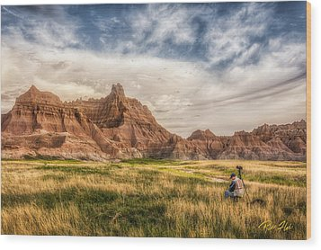 Photographer Waiting For The Badlands Light Wood Print by Rikk Flohr