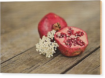 Pomegranate And Flowers On Tabletop Wood Print by Anna Hwatz Photography Find Me On Facebook