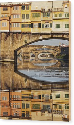 Ponte Vecchio Crossing The River A Wood Print by Jeremy Woodhouse