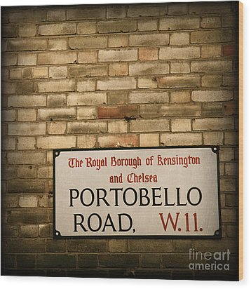 Portobello Road Sign On A Grunge Brick Wall In London England Wood Print by ELITE IMAGE photography By Chad McDermott