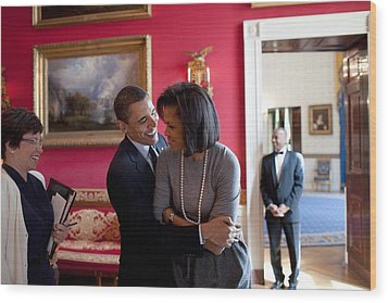 President Obama Hugs First Lady Wood Print by Everett