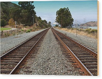 Railroad Tracks With The New Alfred Zampa Memorial Bridge And The Old Carquinez Bridge In Distance Wood Print by Wingsdomain Art and Photography