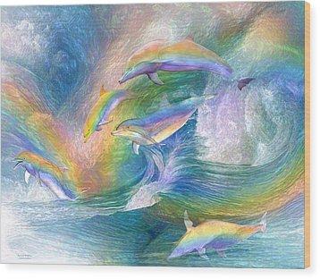 Rainbow Dolphins Wood Print by Carol Cavalaris