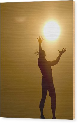 Raising The Sun Wood Print