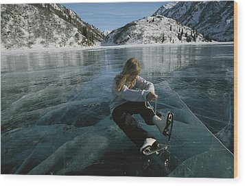Rebecca Quinton Laces Up Her Ice Skates Wood Print by Michael S. Quinton