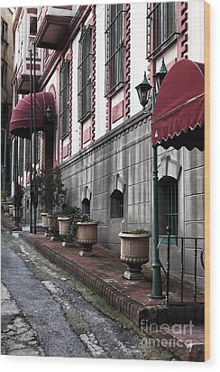 Red Awning Wood Print by John Rizzuto
