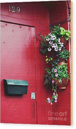 Red Door In Montreal Wood Print by John Rizzuto