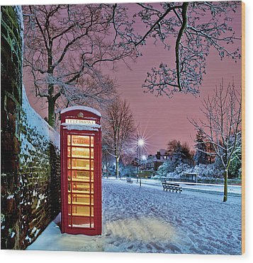 Red Phone Box Covered In Snow Wood Print by Photo by John Quintero