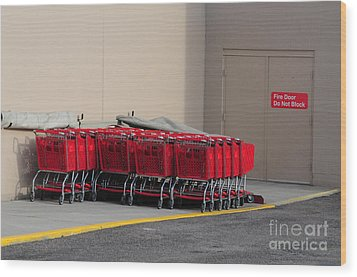 Red Shopping Carts In A Row Wood Print by Merrimon Crawford