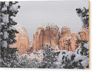 Red Towers Under Snow Wood Print by Laura Pratt