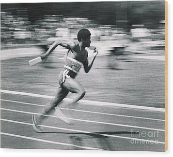 Relay Runner Wood Print by Jim Wright