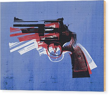 Revolver On Blue Wood Print by Michael Tompsett