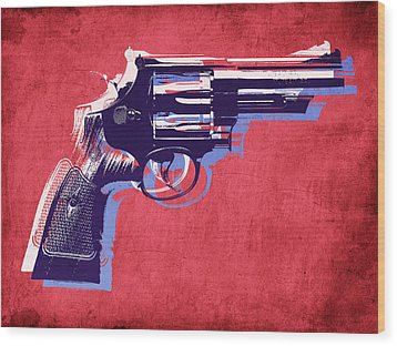 Revolver On Red Wood Print by Michael Tompsett