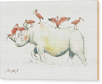 Rhino And Ibis Wood Print by Juan Bosco