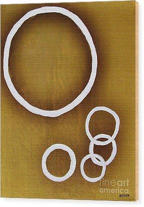 Rings On Gold Wood Print by Marsha Heiken