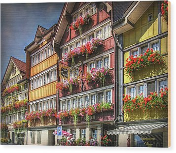 Wood Print featuring the photograph Row Of Swiss Houses by Hanny Heim