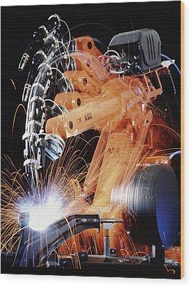 Robot Arm Spot-welding A Car Suspension Unit Wood Print by David Parker