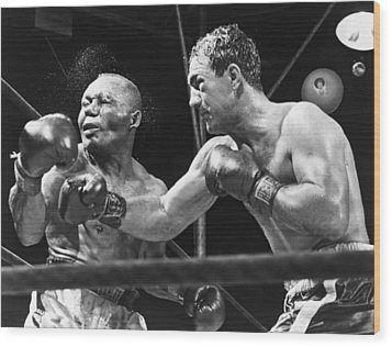 Rocky Marciano Landing A Punch Wood Print by Everett
