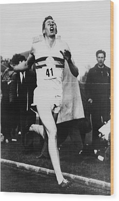 Roger Bannister Crossing The Finish Wood Print by Everett