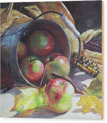 Rolling Apples Wood Print by Donna Munsch