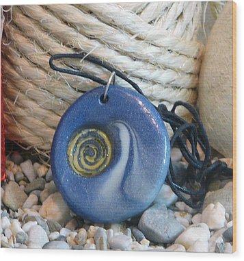 Round Blue Pendant With Spiral Wood Print by Chara Giakoumaki