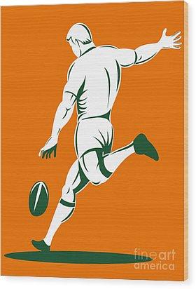Rugby Player Kicking Wood Print by Aloysius Patrimonio