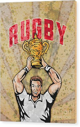 Rugby Player Raising Championship World Cup Trophy Wood Print by Aloysius Patrimonio