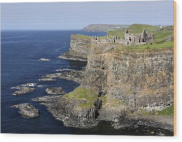 Ruins Of Dunluce Castle On The Sea Cliffs Of Northern Ireland Wood Print by Pierre Leclerc Photography