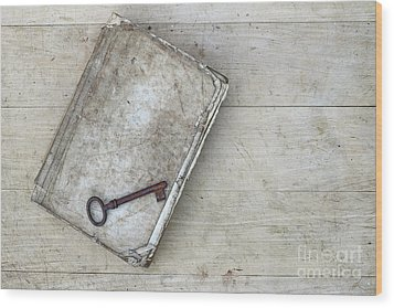 Wood Print featuring the photograph Rusty Key On The Old Tattered Book by Michal Boubin