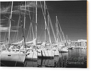 Sailboats Docked Wood Print by John Rizzuto